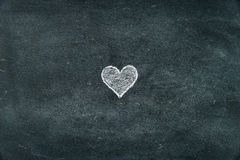 Hand drawing heart shape symbol on blackboard Stock Photography