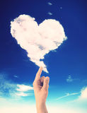 Hand drawing a heart shaped cloud Stock Images