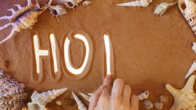 Hand drawing Hotel symbol in the sand. Beach background. Top view stock footage