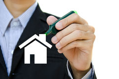 Hand drawing house. Young hand drawing house in a whiteboard Royalty Free Stock Photography