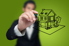 Hand drawing house. Hand drawing house in a whiteboard Royalty Free Stock Photos