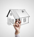 Hand drawing house. On a white background royalty free stock image