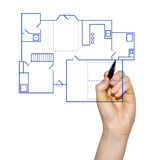 Hand drawing a house blueprint. Hand drafting a blueprint for the construction of a house stock image