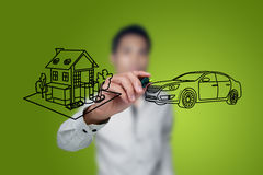 Hand drawing house and car. Hand drawing house and car in a whiteboard Royalty Free Stock Photos