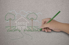 Hand drawing a house with green pencil Royalty Free Stock Photos