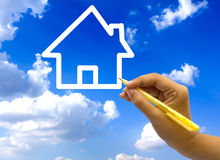 Hand drawing house icon on sky. Royalty Free Stock Photography