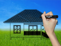 Hand drawing a house on a landscape Stock Photography