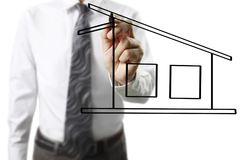 Hand drawing  house. Man hand drawing a house Royalty Free Stock Images