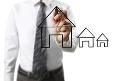 Hand drawing  house. Man hand drawing a house Stock Photo