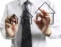 Hand drawing  house. Man hand drawing a house Stock Photography