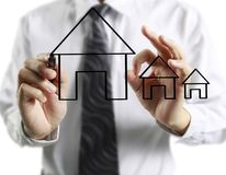 Hand drawing  house. Man hand drawing a house Stock Photos