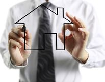 Hand drawing  house. Man hand drawing a house Stock Images