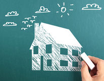 Hand drawing a house Royalty Free Stock Photography