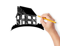 Hand drawing a house Stock Photos