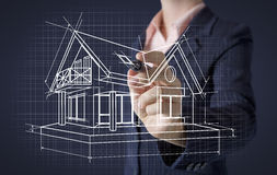 Hand drawing house on screen. Real estate concept royalty free stock image