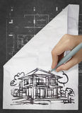 Hand drawing house on wrinkled paper. As concept Stock Image