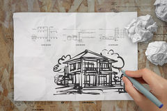 Hand drawing house on wrinkled paper Stock Photos