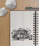 Hand drawing house on wrinkled paper Royalty Free Stock Photos