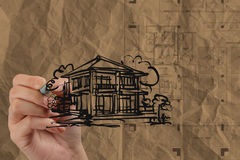 Hand drawing house with wrinkled recycle paper Stock Photo