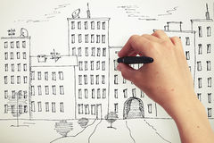 Hand drawing houses on a paper Royalty Free Stock Photo