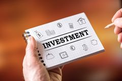 Investment concept on a notepad. Hand drawing investment concept on a notepad stock images