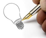 Hand drawing light bulb Stock Photography