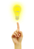 Hand with a drawing light bulb Stock Image