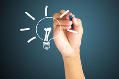 Hand drawing light bulb  as creative concept Royalty Free Stock Image