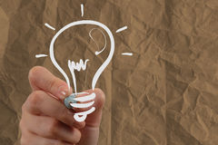 Hand drawing light bulb with crumpled recycle paper Royalty Free Stock Photo