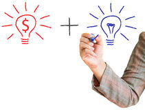 Hand drawing light bulb dollar sign. Positive light bulb concept on a whiteboard Stock Image