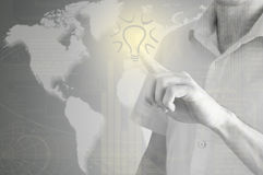 Hand drawing light bulb on the virtual display Royalty Free Stock Image