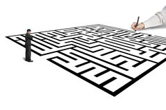 Hand drawing maze with thoughful businessman standing in from Stock Image