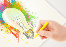 Hand drawing on paper a colorful splatter lightbulb Royalty Free Stock Images