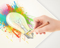 Hand drawing on paper a colorful splatter lightbulb Stock Photography