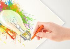 Hand drawing on paper a colorful splatter lightbulb Royalty Free Stock Photography