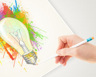 Hand drawing on paper a colorful splatter lightbulb Royalty Free Stock Image