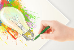 Hand drawing on paper a colorful splatter lightbulb Royalty Free Stock Photos