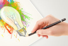 Hand drawing on paper a colorful splatter lightbulb stock illustration