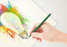 Hand drawing on paper a colorful splatter lightbulb Stock Image