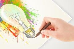 Hand drawing on paper a colorful splatter lightbulb vector illustration