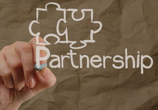 Hand drawing Partnership Puzzle with crumpled recycle paper back Royalty Free Stock Photos