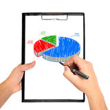 Hand drawing pie chart. On clipboard Stock Image