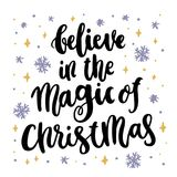 The hand-drawing quote: Believe in the Magic of Christmas, in a trendy calligraphic style. Merry Christmas card. It can be used for card, mug, brochures, poster Stock Photo