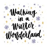 The hand-drawing quote: Walking in a Winter Wonderland, in a trendy calligraphic style. Merry Christmas card. It can be used for card, mug, brochures, poster, t Stock Images