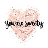 The hand-drawing quote: You are sweety, in a trendy calligraphic style, on a pink gold glitter heart. It can be used for card, mug, brochures, poster, t-shirts Royalty Free Stock Images