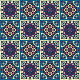 Hand drawing seamless pattern for tile in in dark blue, purple and yellow colors. Royalty Free Stock Photography