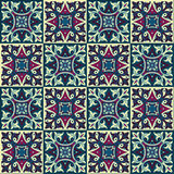 Hand drawing seamless pattern for tile in in dark blue, purple and yellow colors. Royalty Free Stock Photo