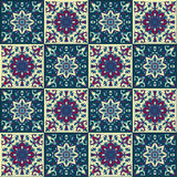 Hand drawing seamless pattern for tile in in dark blue, purple and yellow colors. Royalty Free Stock Images
