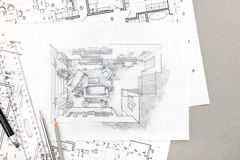 Hand drawing sketch of home interior with pencils and blueprints Stock Photography