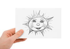 Hand with drawing sun Stock Photo